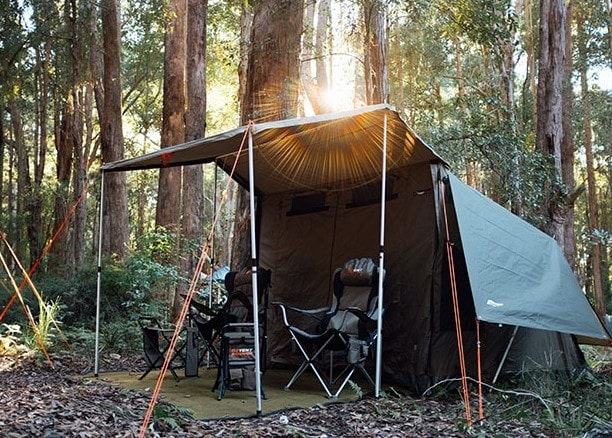 Oztent Tent with two camping chairs in the woods