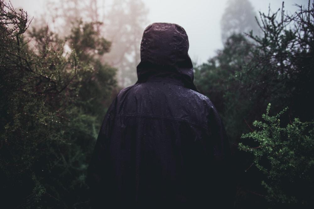 Person under rain wearing a rain jacket