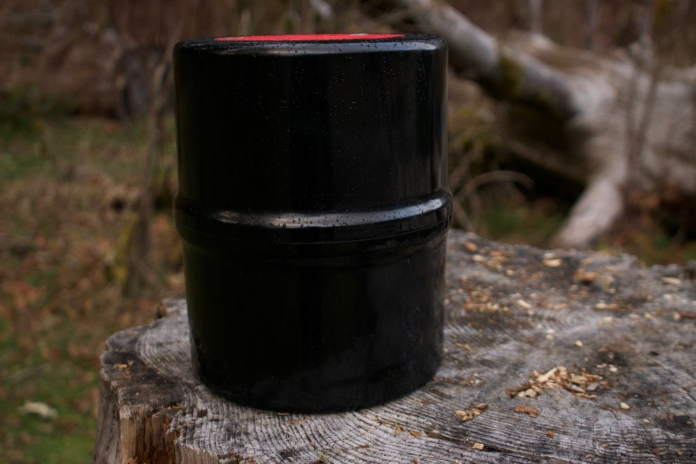Black bear canister on a tree stump