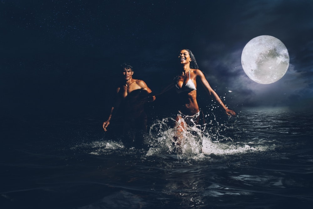 Couple in the beach at night