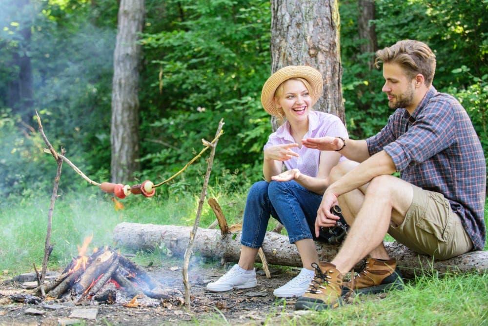 Couple having fun while camping