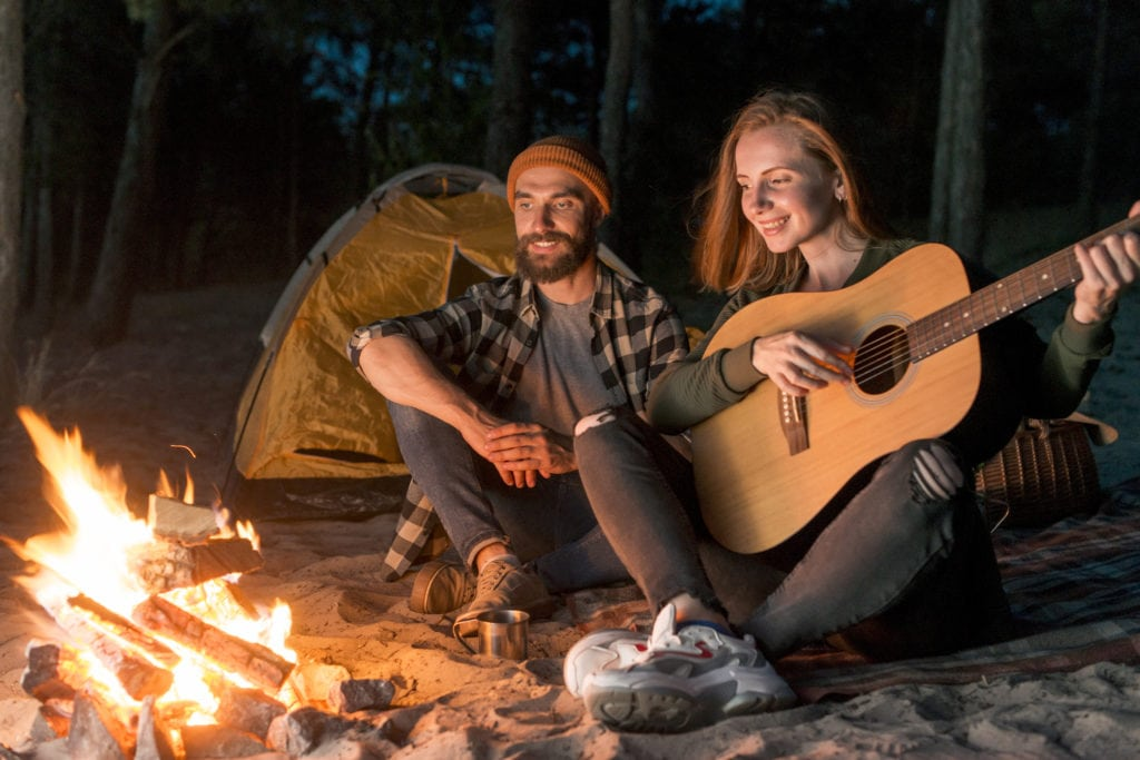 Campfire with a couple singing together