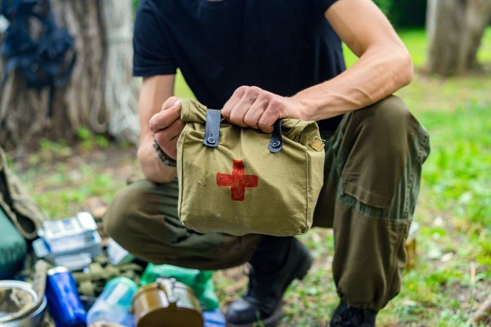 A man holding an emergency kit