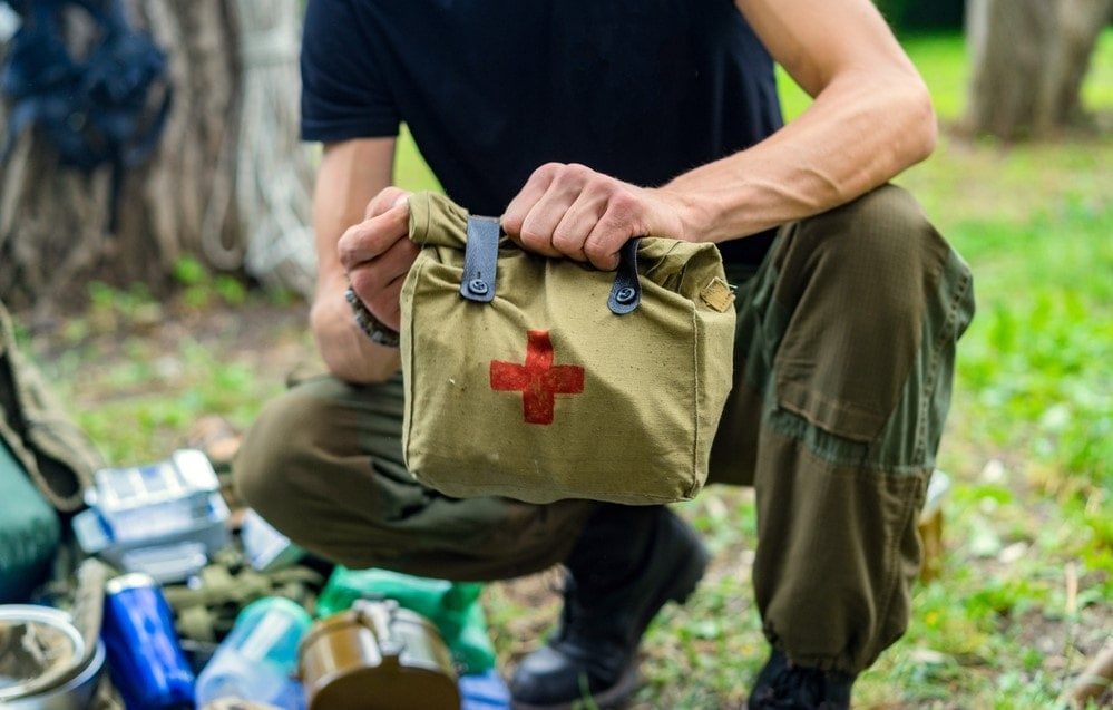 A man holding an emergency first aid kit