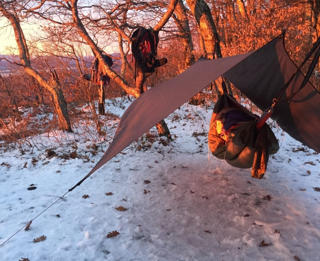 A camping tarp and hammock in winter
