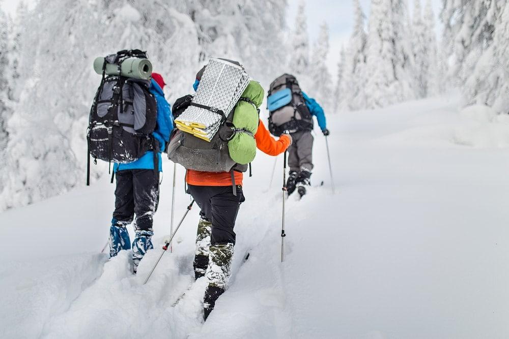 Friends hiking in winter
