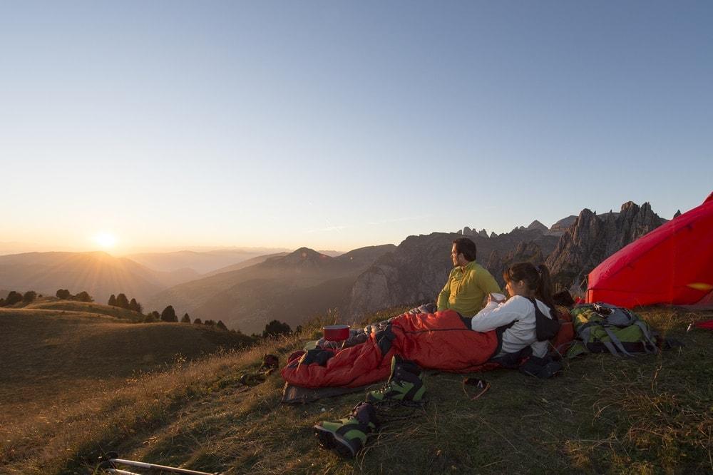 A couple enjoying a sunrise
