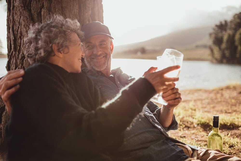 Couple holding wine glasses on a date
