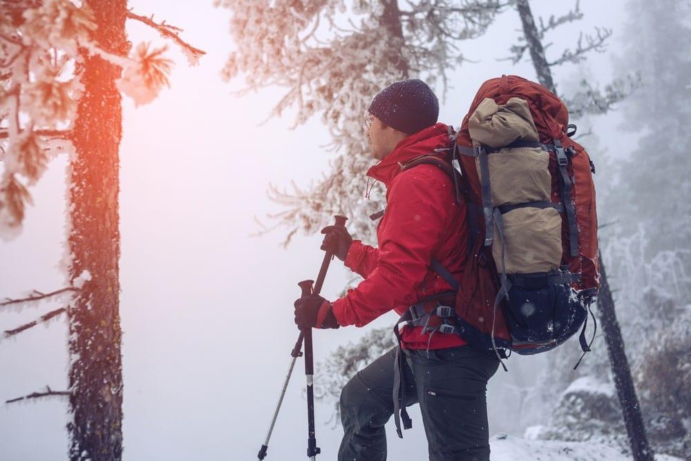 Hiking man in snow
