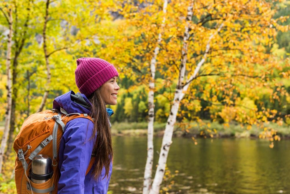 Woman hiker looking at scenic view of fall