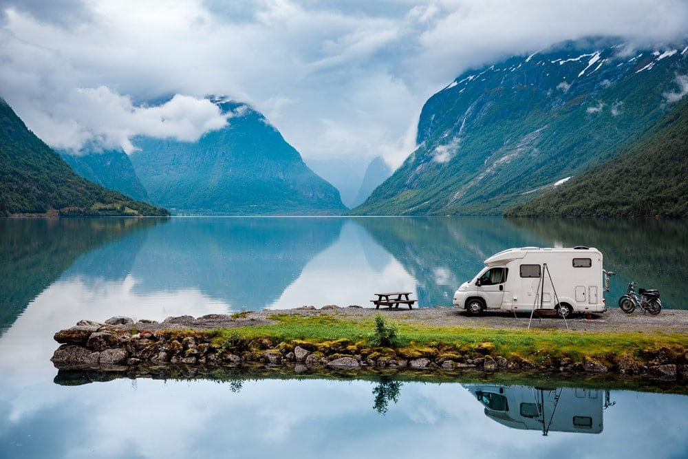 A camper in the middle of a lake