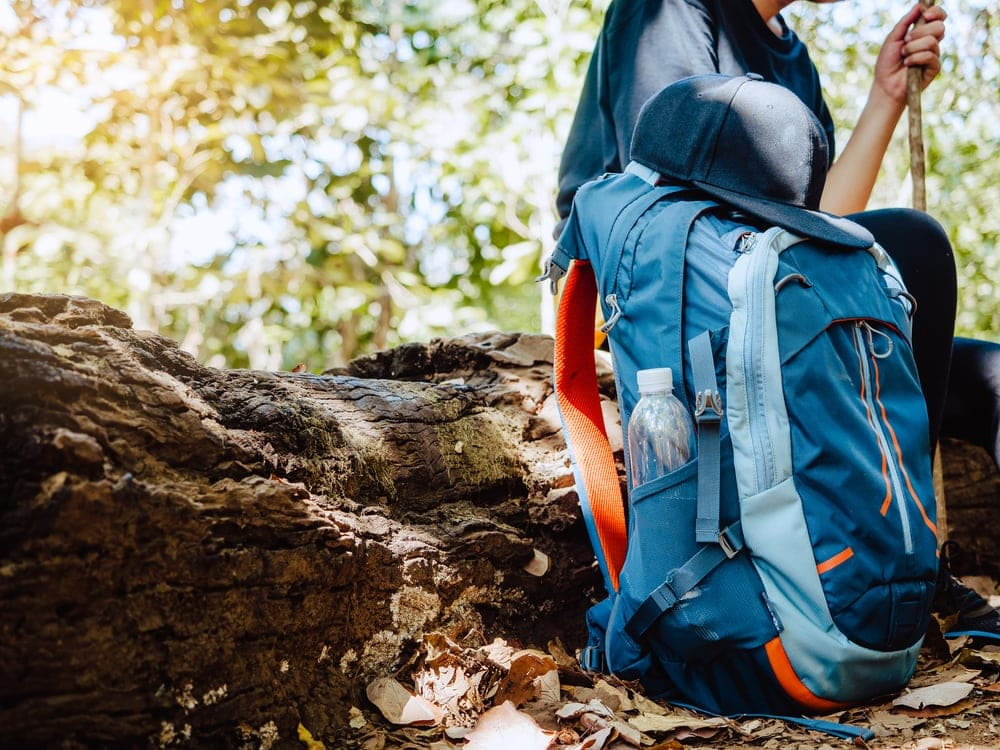 Hiker during rest with her bag in the ground