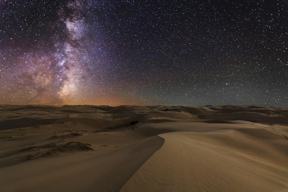 Night view of desert under a starry sky