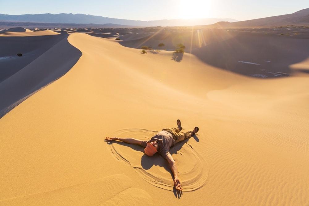 Man lying in desert sand