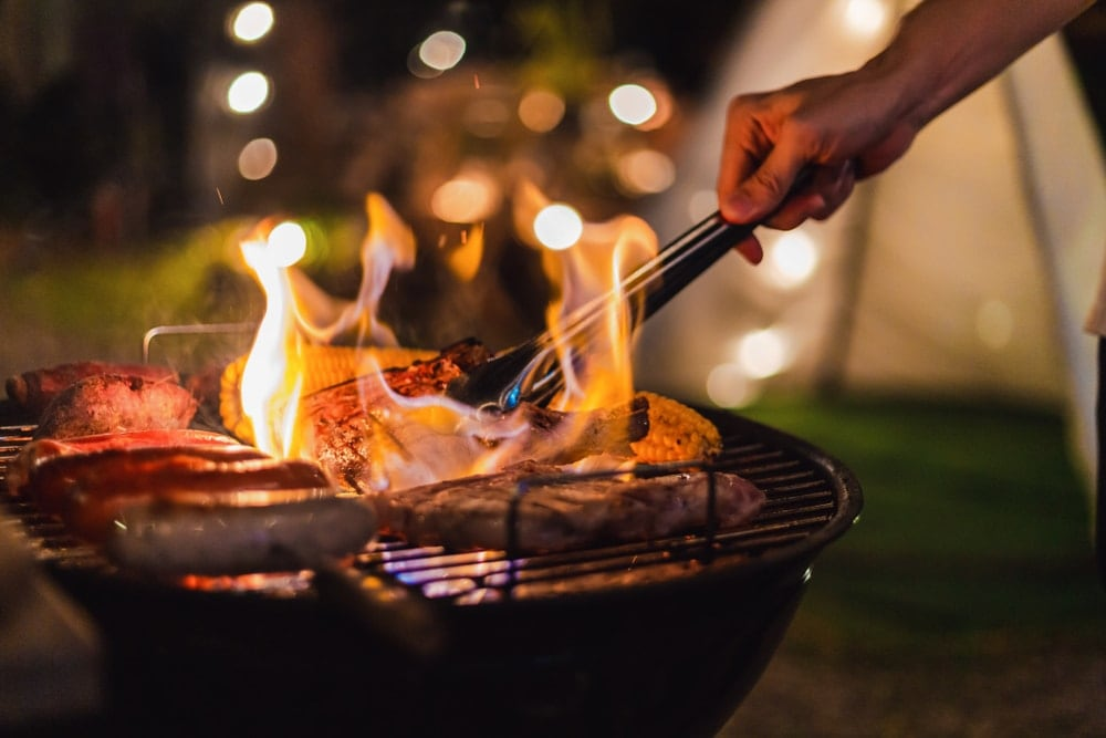 Grilling outdoors with barbecue