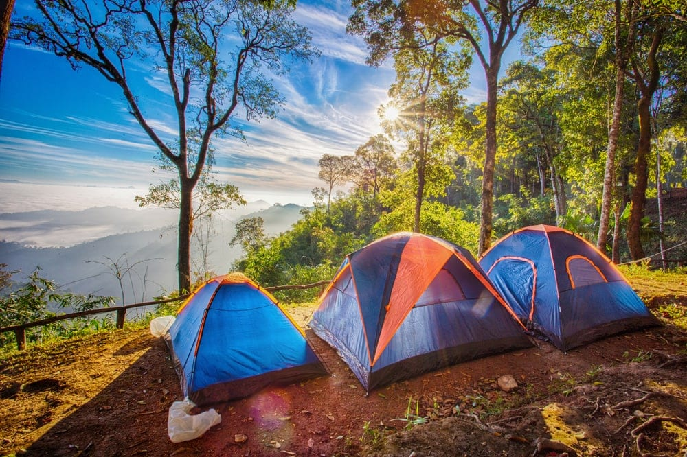 Camping fast pitch tents with amazing sunrise view