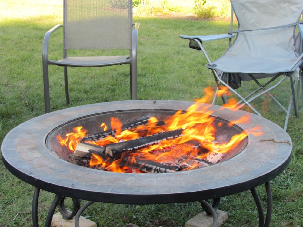 Portable fire pit with burning fire