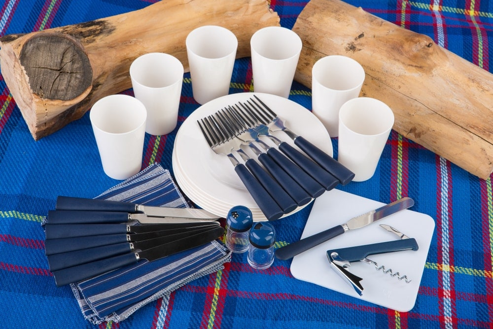 Complete tableware set spread out on a table
