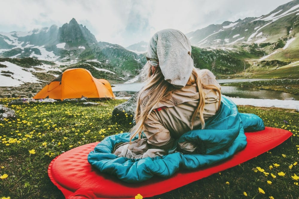 Woman looking at her camping tent