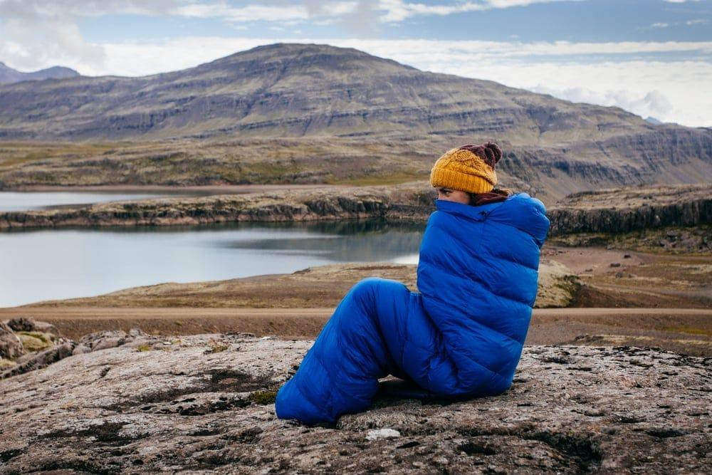 Woman staying warm inside a sleeping bag