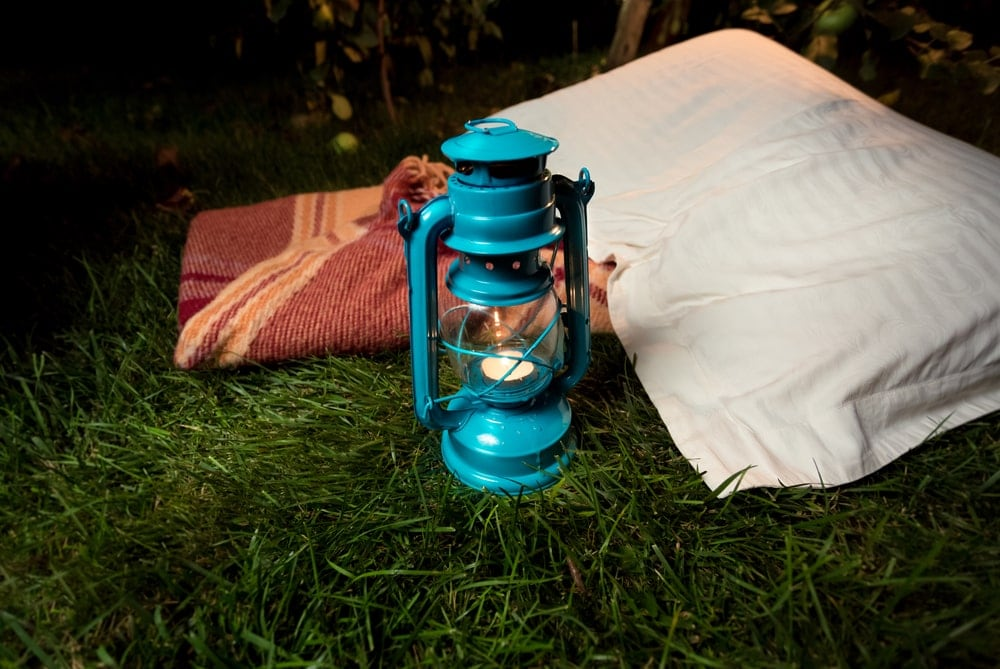 Pillow and a camping lanter on the ground