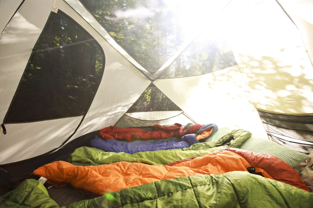 Sleeping bag lining up inside a camping tent