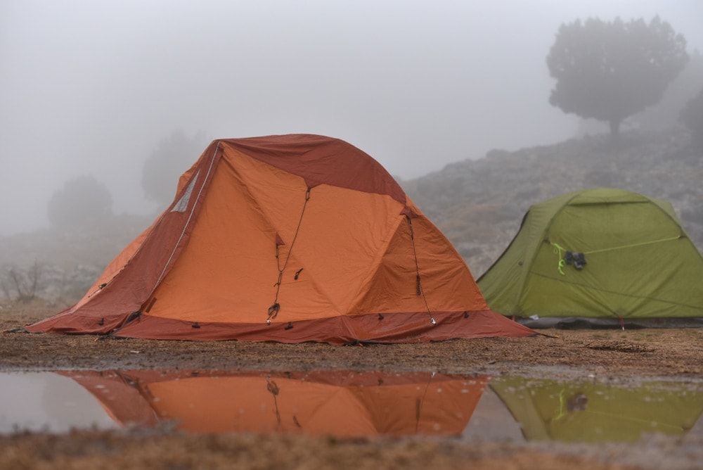 Camping tent with water beside