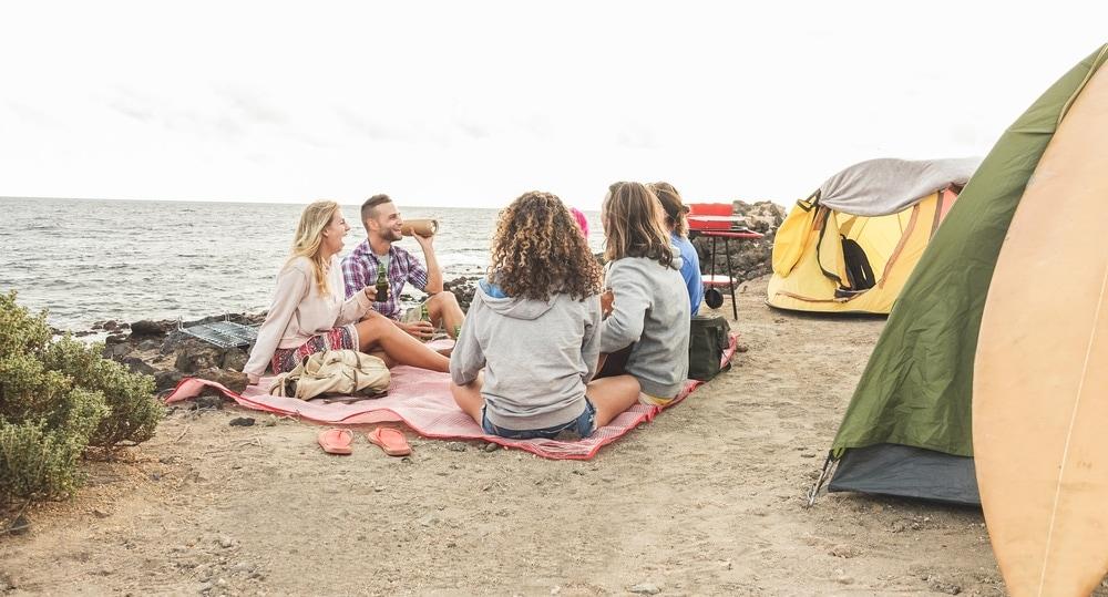 Friends camping in the beach