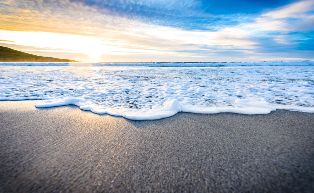 Beach waves touching sand