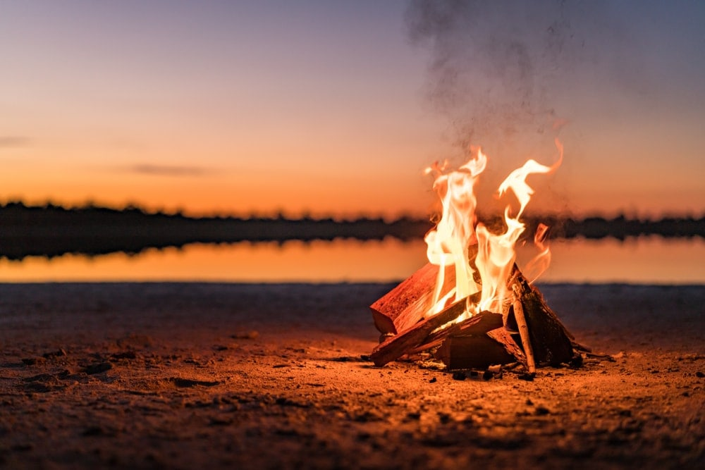 campfire during on a beach camping