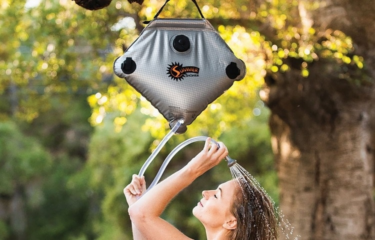 woman showers while camping