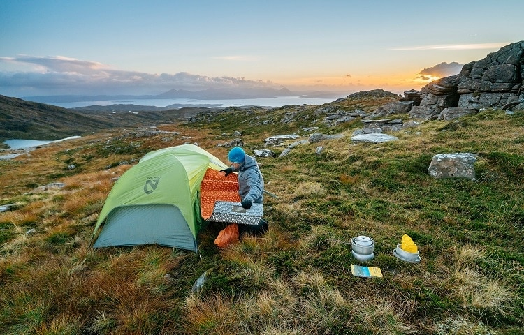 man preparing tent