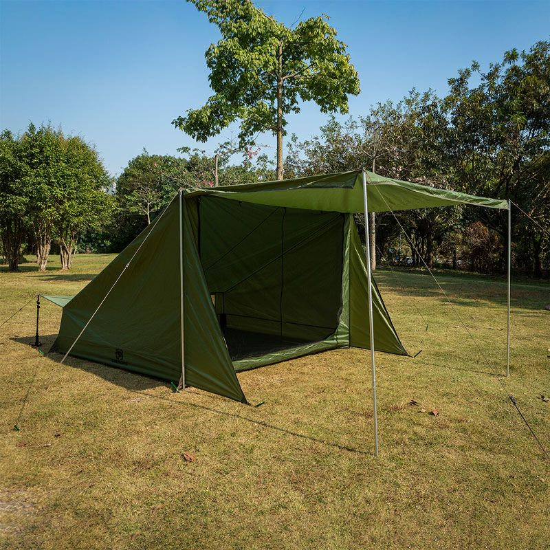 Baker style camping tent in a campground