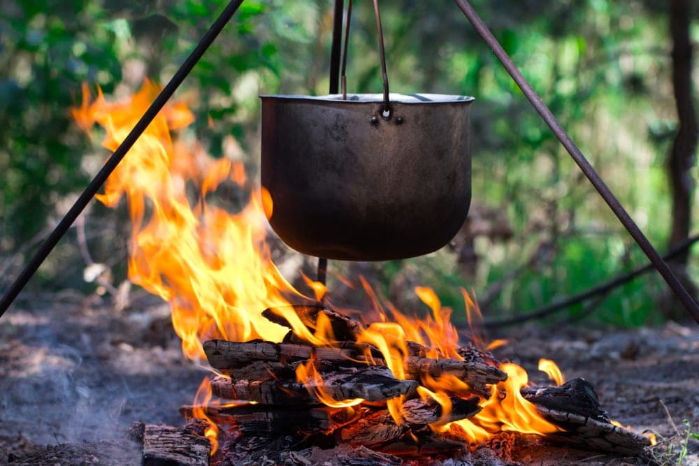 Pot over a campfire to boil water while camping