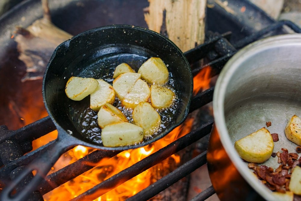 Potatoes cooked over campfire as camping food