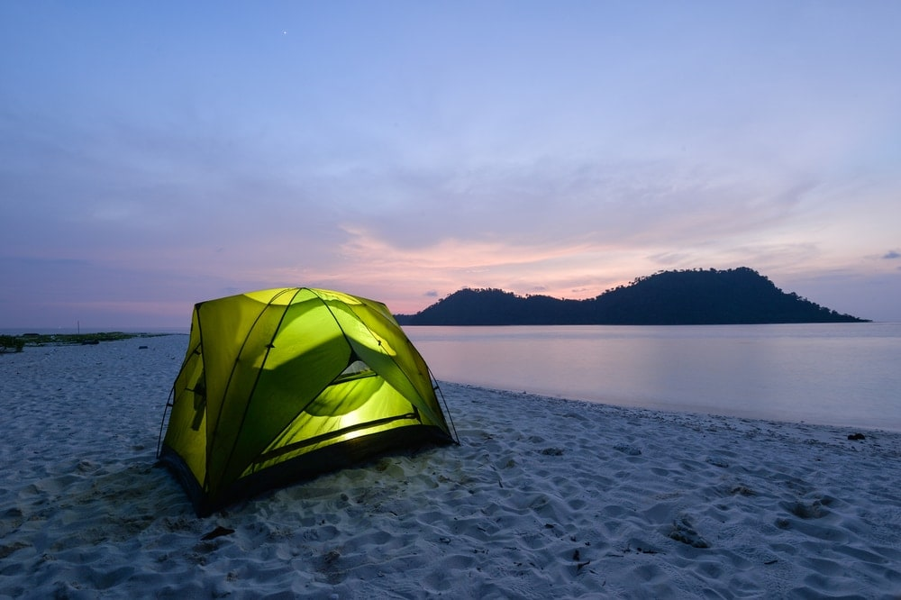 Beach camping tent beside on the sand