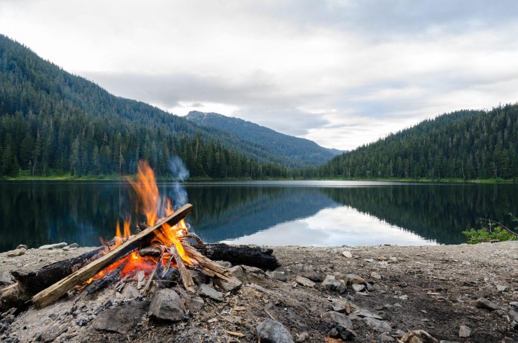 Camping bonfire near the lake
