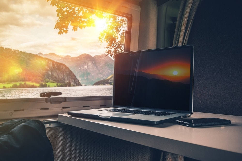 Laptop inside a RV with outdoor view