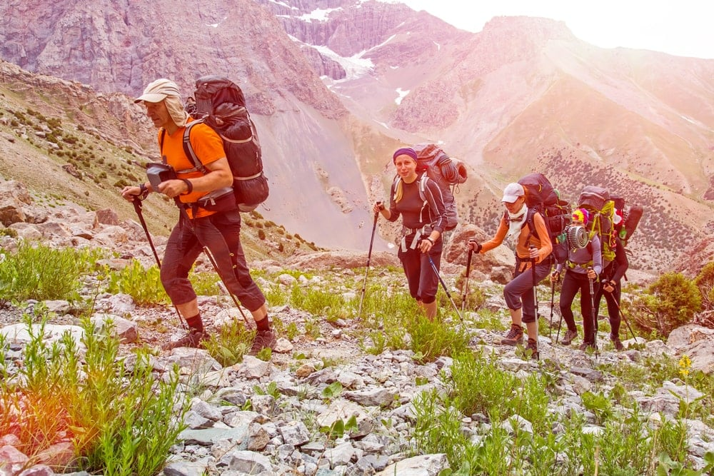 Outdoor guide leading hikers on the mountain