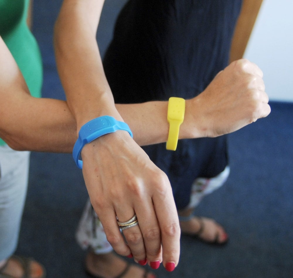 Arms wearing mosquito bracelets