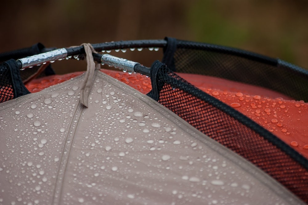 Rain drops on the top edge of a camping tent
