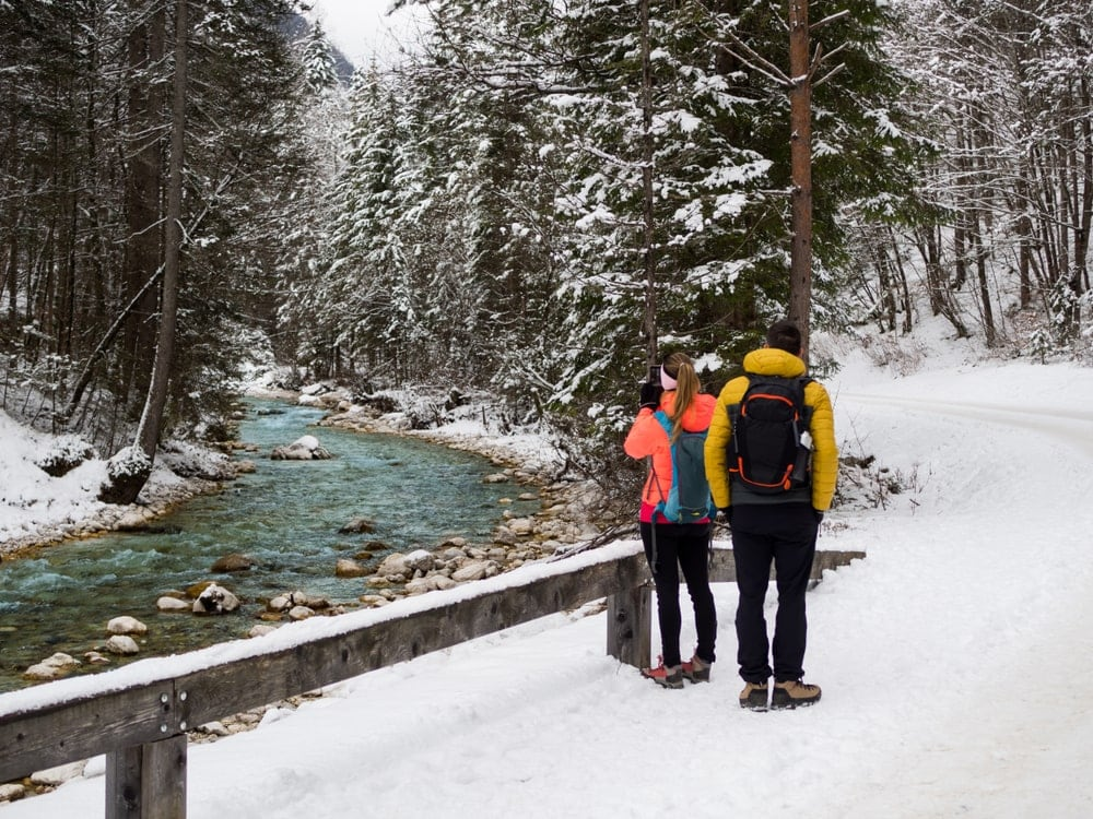 Hikers taking a picture of a river