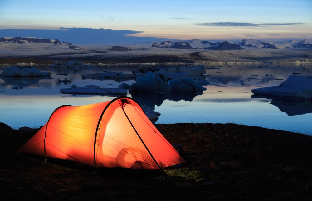 Lighted tunnel camping tent in the arctic