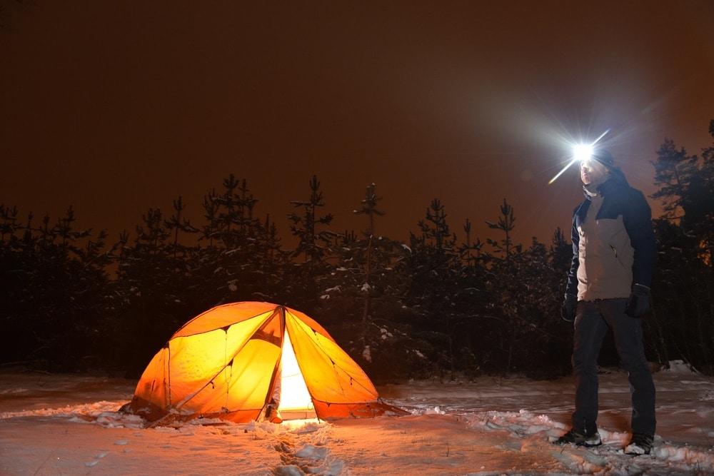 Man outside a tent