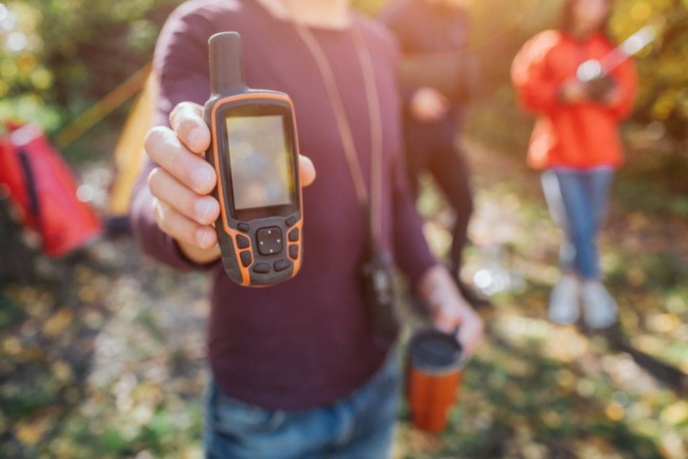 Man holding a communication device for hiking
