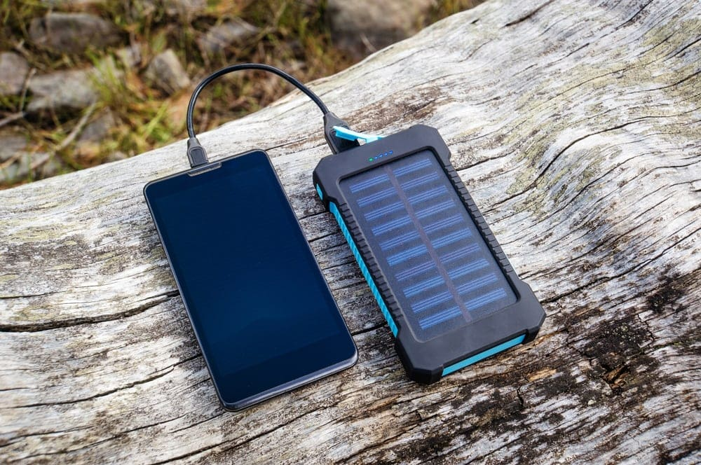 A cellphone and a powerbank for hiking