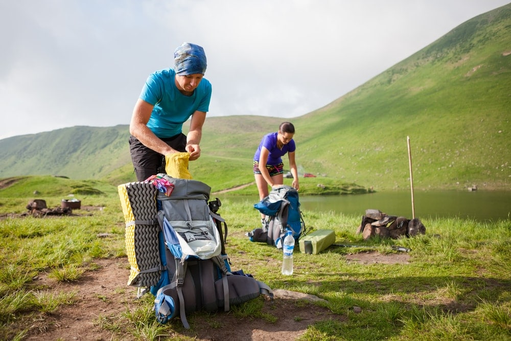Hikers packing their hiking gears