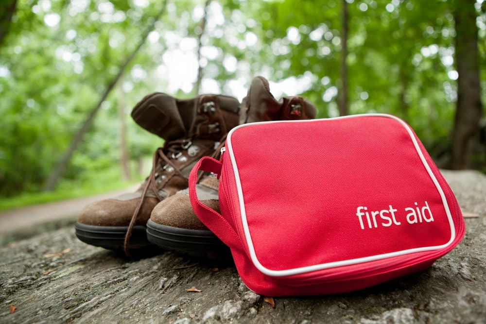 First aid kit and a hiking boots