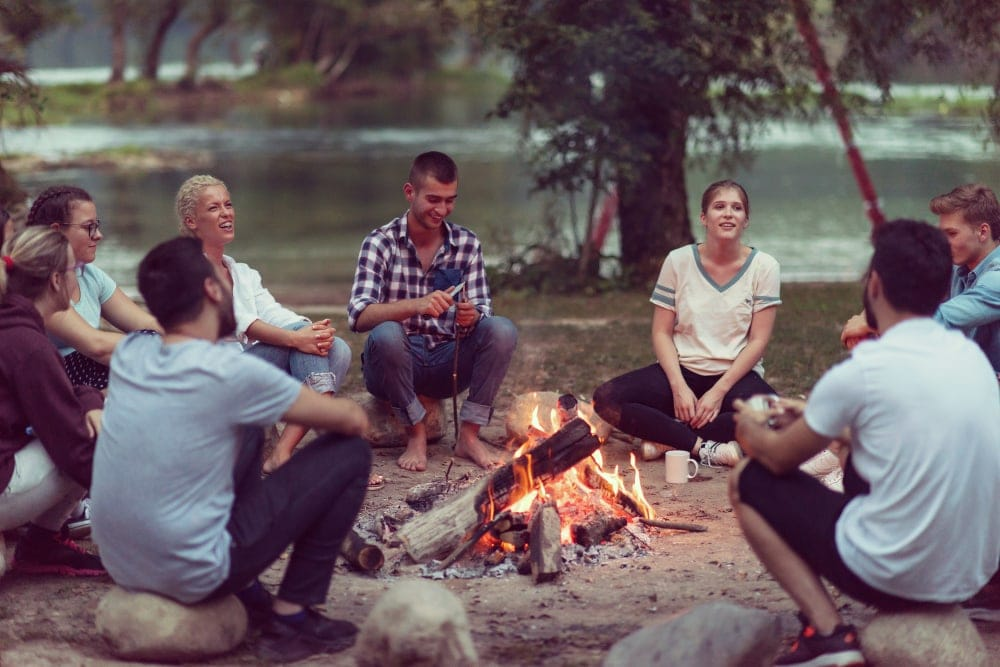 Group of friends hanging out and playing campfire games