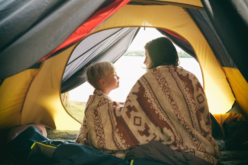 Mother and son inside a tent